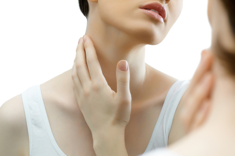 woman looking at neck skin
